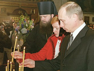 Putin and wife Lyudmila in New York at a service for victims of the September 11 attacks, 16 November 2001 Vladimir Putin in the United States 13-16 November 2001-55.jpg