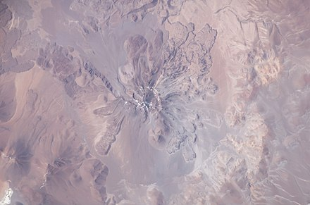 Socompa from space, the sector collapse deposit lies on the upper side Volcan Socompa (ISS006-E-13815).jpg