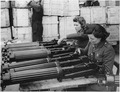 Water-cooled machine guns just arrived from the USA under lend-lease are checked at an ordnance depot in England. - NARA - 196325.tif