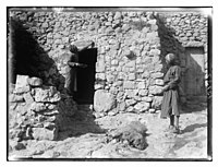Weli of Budrieh at Sherafat and the preparing of a sacrifice. Smearing the blood of the sacrifice over the door LOC matpc.04622.jpg
