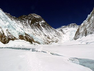 Lhotse - The Western Cwm. The Lhotse Face (centre right) is connected to Mount Everest (centre left) by the South Col (centre, lowest point on horizon).