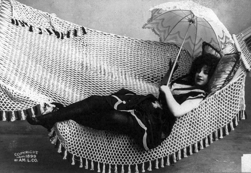 File:Woman lying in hammock holding parasol cph.3b11256.jpg