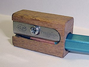 Image of a wooden pencil sharpener.