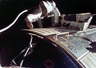 Alfred Worden - Worden performing humanity's first deep-space EVA during Apollo 15's homeward journey