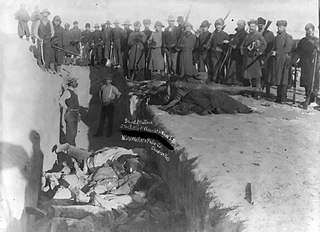 Wounded_Knee_1891.jpg: About 300 Lakota Indians were buried in a mass grave at the