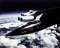 X-15 Mounted to B-52 Mothership Pylon in Flight - GPN-2000-000141.jpg