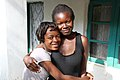 Young mothers Brenda, 16, with her sister Atupele, 18 - A reality for girls (7497734706).jpg
