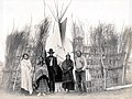 """A village of the Arapahoes (sic)."" (Arapaho family group in front of a teepee in the Department of Anthropology at the 1904 World's Fair.jpg"