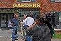 (Hurricane Katrina) New Orleans, LA, 4-19-06 -- FEMA public affairs video photographer Iabil Garza videotapes public information officer Harry (Leo) Skinner speaking with TV-WDSU 6 - DPLA - fb5506313962577c7ccee839c7fff8e4.jpg