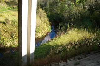 The river Sesuva under Karmelava-Jonava road the bridge