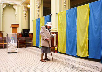 Elections in Ukraine - A woman with ballot during Ukrainian parliamentary election, 2007