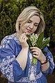 День Вишиванки. Молода україночка у вишитій синій сукні серед квітів 23.jpg