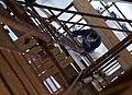 Художник Юрий Африн поднимается под шатровый купол во время росписи храма.jpg