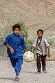 کودکان در منطقه سیستان و بلوچستان ایران در حال بازی فوتبال.jpg