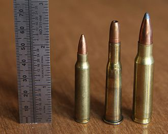 .25-35 Winchester - .25-35 Winchester (center) with .223 Rem (left) and .308 Win (right).