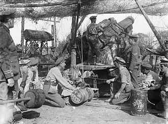 """BL 12-inch howitzer - Shell marked """"For Fritz"""" is readied for loading, bombardment of Thiepval September 1916"""