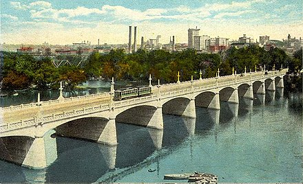 By the early 20th century Richmond had an extensive network of electric streetcars, as shown here crossing the Mayo Bridge across the James River, ca. 1917 14th Street Bridge, Richmond, ca 1917.jpg