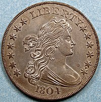 The obverse of a coin depicting an allegorical woman