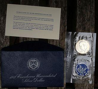 """Eisenhower dollar - 1973-S """"blue Ike"""": envelope, pliofilm coin holder, and printed insert"""