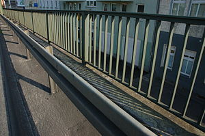 Traffic barrier - Traffic barrier with a pedestrian guardrail behind it