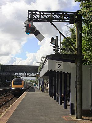Liskeard railway station - A train for London approaches the distinctive 'gallows' signal which is underslung to allow drivers to see it clearly