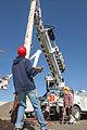 2013 Construction Day - Setting a power pole with a boom truck (8777556830).jpg