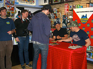 The New 52 - Jim Lee and Geoff Johns at a May 11, 2012 signing for the Justice League Vol. 1: Origin, the hardcover which collected the first six-issue story arc of that series