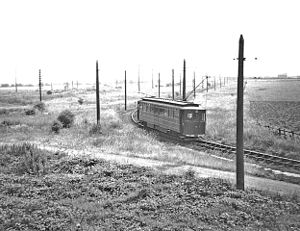Grimsby and Immingham Electric Railway - An ex-GCR car leaves Immingham Town for Grimsby on 1 July 1961. On the far left is the Grimsby District Light Railway