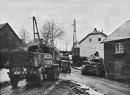 American soldiers of the 99th Infantry Division enter the Belgian village of Wirtzfeld, late 1944. 99th Infantry Division Moving Through Wirtzfeld.jpg