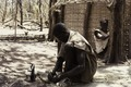 ASC Leiden - Coutinho Collection - C 24 - Life in Sara, Guinea-Bissau - Man knotting a mat - 1974.tif