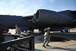 A U.S. Airman, crew chief with the 5th Aircraft Maintenance Squadron, 5th Bomb Wing, pulls an air duct to connect the air supply with a B-52H Stratofortress aircraft prior to a mission at Minot Air Force Base 120810-F-RB551-104.jpg