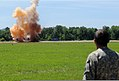 A U.S. Soldier assigned to the 202nd Explosive Ordnance Disposal Company, 201st Regional Support Group, Alabama Army National Guard, watches an explosive demonstration during exercise Ravens Challenge VIII 140702-Z-WV152-408.jpg