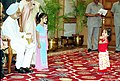 A little girl performs dance after tying Rakhi to the Prime Minister Dr. Manmohan Singh on the auspicious occasion of 'Raksha Bandhan' in New Delhi on August 30, 2004.jpg
