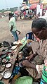A native Hausa man mending shoes....A shoe maker.jpg