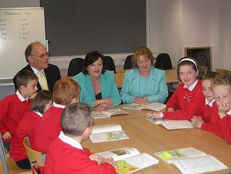 Education in Scotland - Pupils and Early Years Minister Adam Ingram, Education and Lifelong Learning Secretary Fiona Hyslop and Schools and Skills Minister Maureen Watt with pupils at Avenue End Primary Campus in Glasgow.