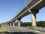 Airtrain along and above Qantas Drive, Brisbane Airport.jpg