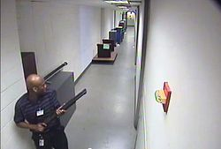 CCTV footage of Aaron Alexis in building 197 holding a Remington 870 shotgun.