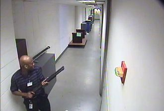Washington Navy Yard shooting - CCTV footage of the shooter in building 197 holding a Remington 870 shotgun.