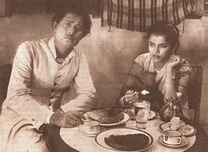 Mukh O Mukhosh - Ali Mansoor and Zahrat Ara in a scene.