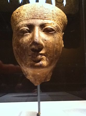 Goddess - The head of an Egyptian goddess. The gender is suggested by the lack of a beard, and the simple hairstyle points to the divine status of the subject.