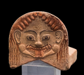 Ancient greek polychrome Gorgona antefix Eretria Greece.png