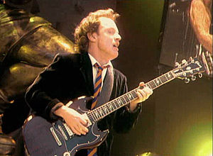 Angus Young - Young performing live in 2001 on the Stiff Upper Lip tour in Germany