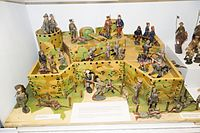 Antique toy soldiers in fort (26706788956).jpg