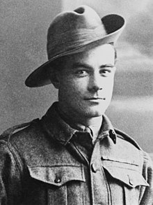 a head and shoulders portrait of a soldier in uniform wearing a broad-brimmed hat turned up on one side