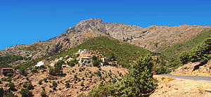 Asco, Haute-Corse - Panorama of the village at the foot of the escarpment of Monte Padro
