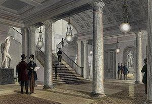 Athenaeum Club, London - The hall of the club in 1841. The statue of Venus can be seen in its present position on the far wall, but the two statues seen on either side of the staircase were later removed.