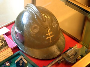 "Free France - Free French Forces Adrian helmet with the Cross of Lorraine replacing the 1939–1940 French Republic ""RF"" emblem"