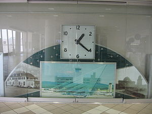 Birmingham Terminal Station - Clock displayed in the Birmingham International Airport terminal which once hung above the main entrance doorway of the 1962 Birmingham Air Terminal. Modified from its original appearance, the clock now includes photos of the key transportation hubs which served Birmingham, the current terminal, the 1931 terminal, and Terminal Station.
