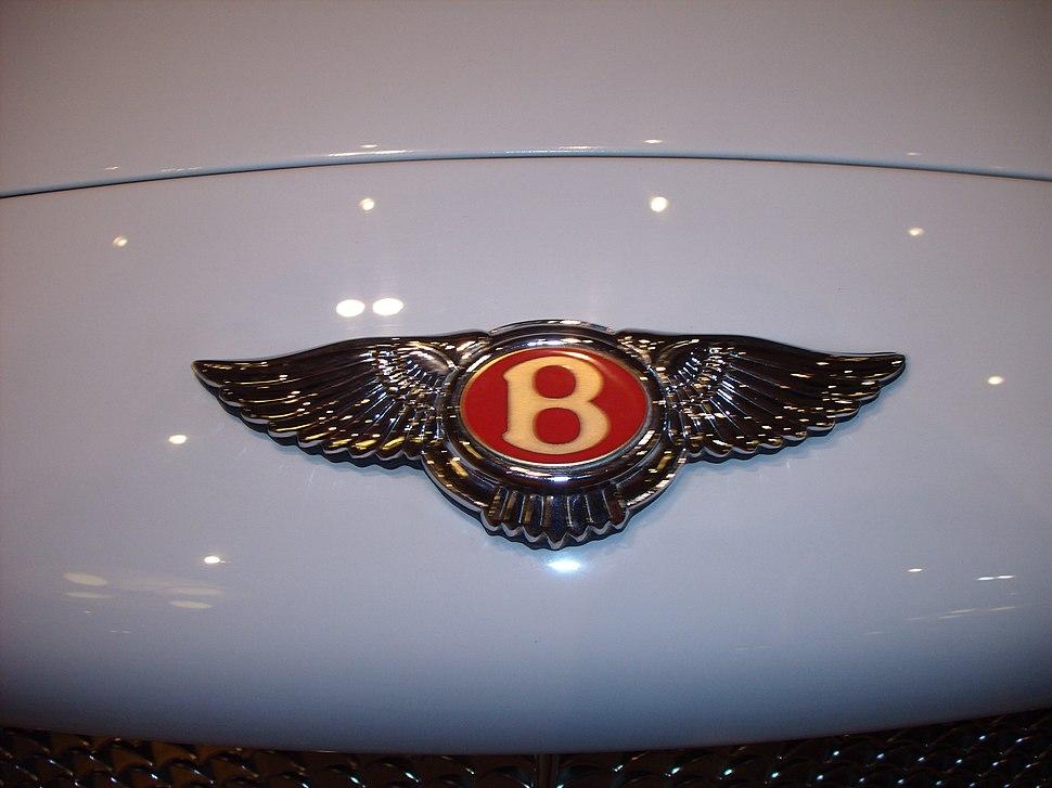 Bentley Logo on White Car