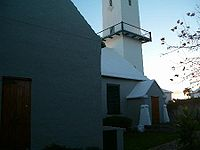 Saint Peter's Church, in St. George's, Bermuda, is the oldest Church of England (now Anglican) church outside the British Isles. Consecrated in 1612, it was rebuilt more than once.